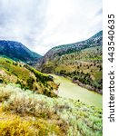 Small photo of The rapidly flowing and silt laden Fraser River during spring as it flows toward the Town of Lillooet in British Columbia, Canada