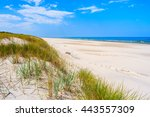 A View Of White Sand Beach And...
