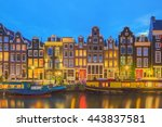 Stock photo amstel river canals and night view of beautiful amsterdam city netherlands 443837581