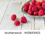 ripe raspberries on a wooden...   Shutterstock . vector #443843401