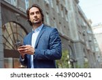 cheerful businessman messaging... | Shutterstock . vector #443900401