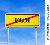 Small photo of Conceptual image for protection of human rights - FGM abbreviation written on yellow street sign and crossed off, over blue sky.