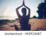 woman sitting in yoga pose on... | Shutterstock . vector #443913487