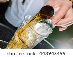 whiskey drink being poured  | Shutterstock . vector #443943499