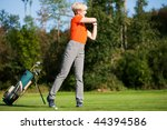 Senior Female Golfer Doing A...