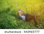 Small photo of Young man holding book in the green meadow. Free happy man. Knowledge is power. Thirst for knowledge.