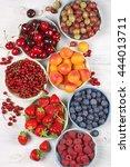 various fresh fruits in bowls... | Shutterstock . vector #444013711