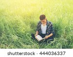 young hipster man sitting on... | Shutterstock . vector #444036337