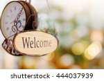 wood welcome sign hanging with... | Shutterstock . vector #444037939