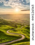 a long and winding road passing ... | Shutterstock . vector #444126565