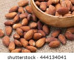 Closeup Of Almond With Salt In...