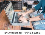 female working on laptop in a... | Shutterstock . vector #444151351