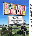 "Small photo of MONTEAGLE, TN-JUNE 24, 2016: Sign for the ""Amish Hippie"", an alternative gift shop in the hills of Tennessee."