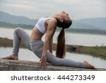 young woman doing yoga exercise ... | Shutterstock . vector #444273349