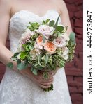 bride holding wedding bouquet | Shutterstock . vector #444273847