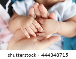 photo of newborn baby feet and... | Shutterstock . vector #444348715