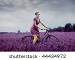 Woman Riding Bike Through A...