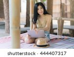 asian woman is relaxing on her... | Shutterstock . vector #444407317