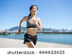 woman running in seaside... | Shutterstock . vector #444433435