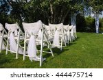 white decorated chairs on a... | Shutterstock . vector #444475714