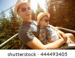father and little son using... | Shutterstock . vector #444493405