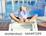 Woman In White Hat Lying On A...