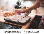 Woman Cooking Cupcakes Closeup...