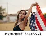 Girl With American Flag Smilin...