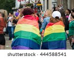 Small photo of LONDON, JUNE 25, 2016: LGBT Gay Pride Parade Two Woman Wrapped In Rainbow Flags