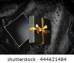 open black gift box with golden ...   Shutterstock . vector #444621484