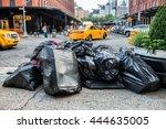 Black Bags Of Trash On Sidewal...