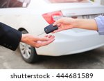 business hand giving a key for... | Shutterstock . vector #444681589