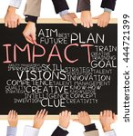 Small photo of Photo of business hands holding blackboard and writing IMPACT concept
