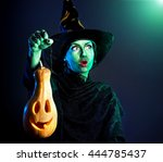 Witch With Green Skin Holding...