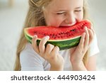 funny kid eating watermelon.... | Shutterstock . vector #444903424