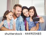 family smiling while taking... | Shutterstock . vector #444905485