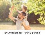 piggyback of baby and dad | Shutterstock . vector #444914455