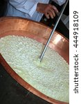 cheesemaker stirs the curds and ... | Shutterstock . vector #444918109