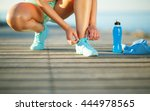 running shoes   woman tying... | Shutterstock . vector #444978565