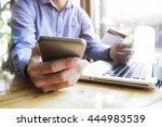 man using laptop and mobile... | Shutterstock . vector #444983539