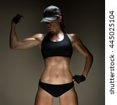 a very fit woman posing her... | Shutterstock . vector #445025104