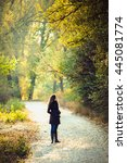 Girl Walks In Beautiful Autumn...