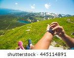 hiking man checking direction... | Shutterstock . vector #445114891