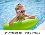 little boy swimming in the pool ... | Shutterstock . vector #445149511