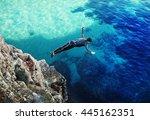 a diver jumps off a cliff | Shutterstock . vector #445162351