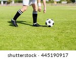 football player picking up the... | Shutterstock . vector #445190917