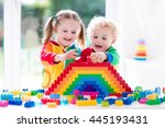 child playing with colorful... | Shutterstock . vector #445193431