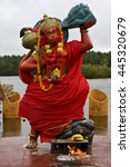 Small photo of marble wood statue of a Hinduism monkey Shiva vishnu Brahma in a temple near a lake in mauritius africa