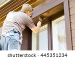 man with paintbrush painting... | Shutterstock . vector #445351234