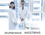 two scientists stand by the... | Shutterstock . vector #445378945